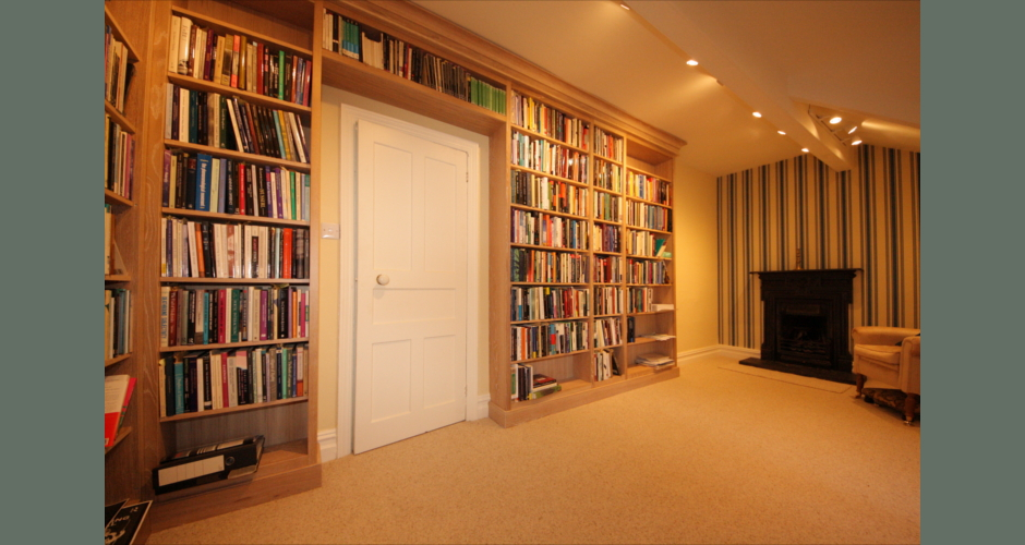 Built-in book shelves in limed oak