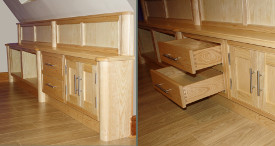 Cabinetry made in ash and built-in under a sloping ceiling